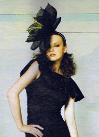 large_black_flower hat on model