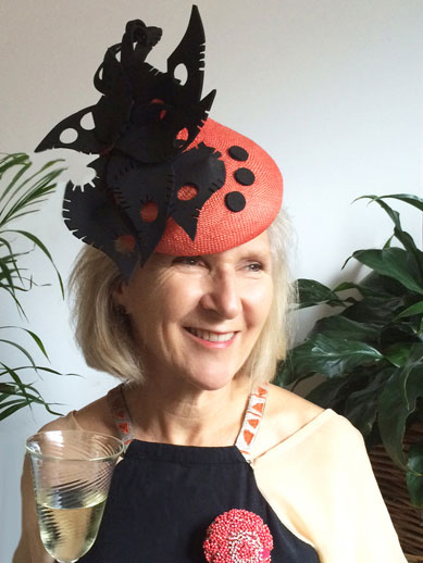 mother of the bride in red and black hat