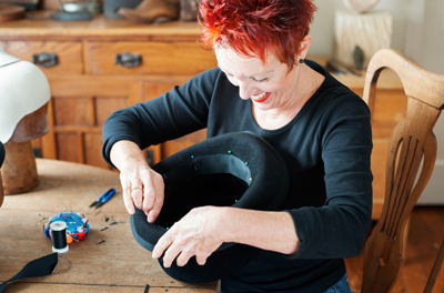 Wendi from Philadelphia Philpot Millinery creating a felt top hat